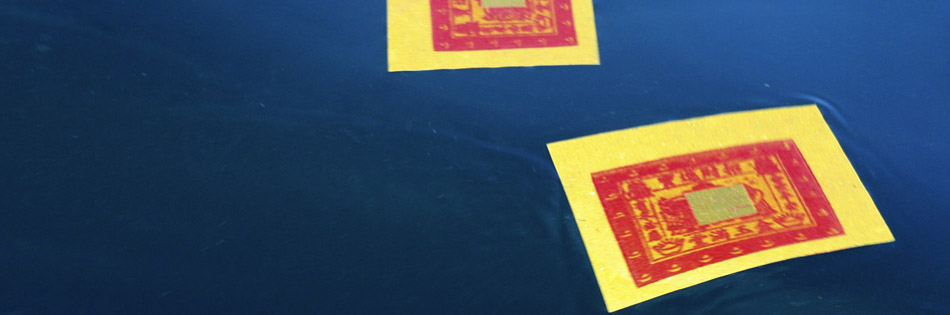 I watched a fishing boat in Indonesia scatter these cards on the ocean before setting out to sea.