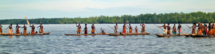 The Asmat people paddle their canoes standing up -- an incredible feat of balance and strength and coordination.