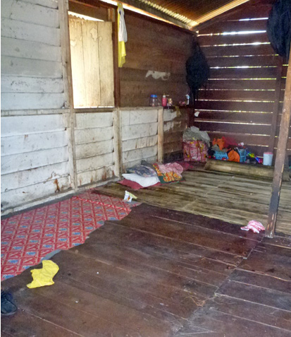 People in the Asmat live very simply without many belongings.  In this shot you see the sleeping mat on the floor to the left and a family's few odds and ends.