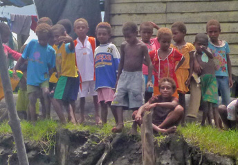 Asmat Kids on the River Bank