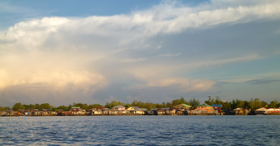 Sunset over the Asmat village of Agats.  Life in and amongst the mangrove trees.