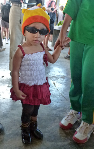 I just had to take this photo of a little girl in her shades and shiny boots in the market of Kokas in the MacCluer Gulf of Western Papua, Indonesia.  She's priceless.