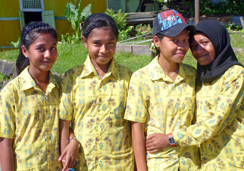 Students who were allowed out of school to greet our ship in Kokas, in the MacCluer Gulf of Western Papua, Indo.  Hundreds of kids walked us from their traditional market into the town for dances, speeches, and welcomes.