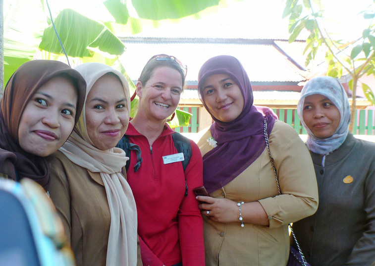 A photo taken with ladies outside a welcome ceremony in Toli Toli, Sulawesi, Indonesia.  I love the face of the woman on the far left.