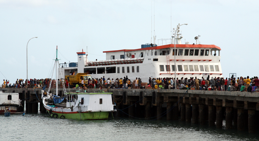 A busy ferry dock where hundreds of people loaded and unloaded themselves and their goods.