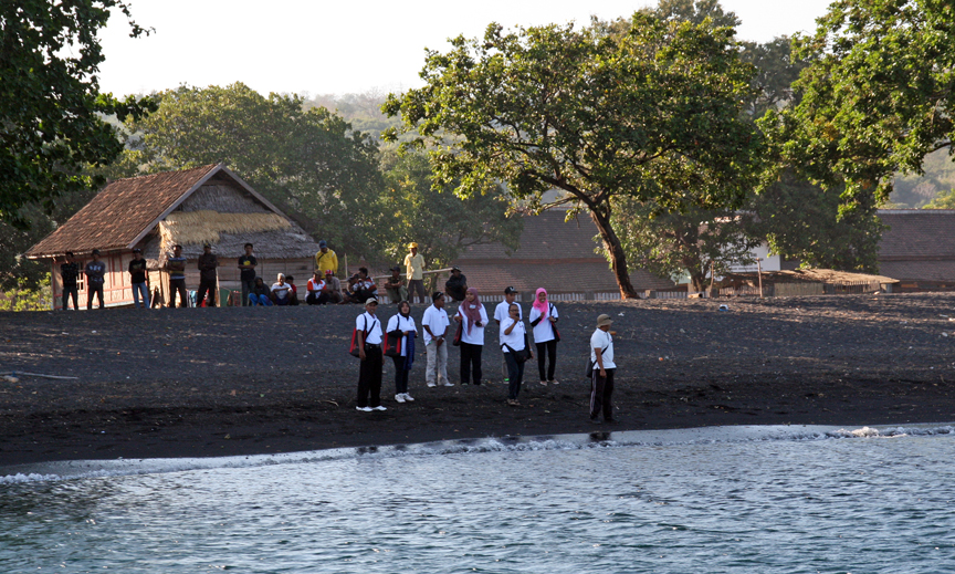 Black sand beaches and local guides greet us in Kananga Village.