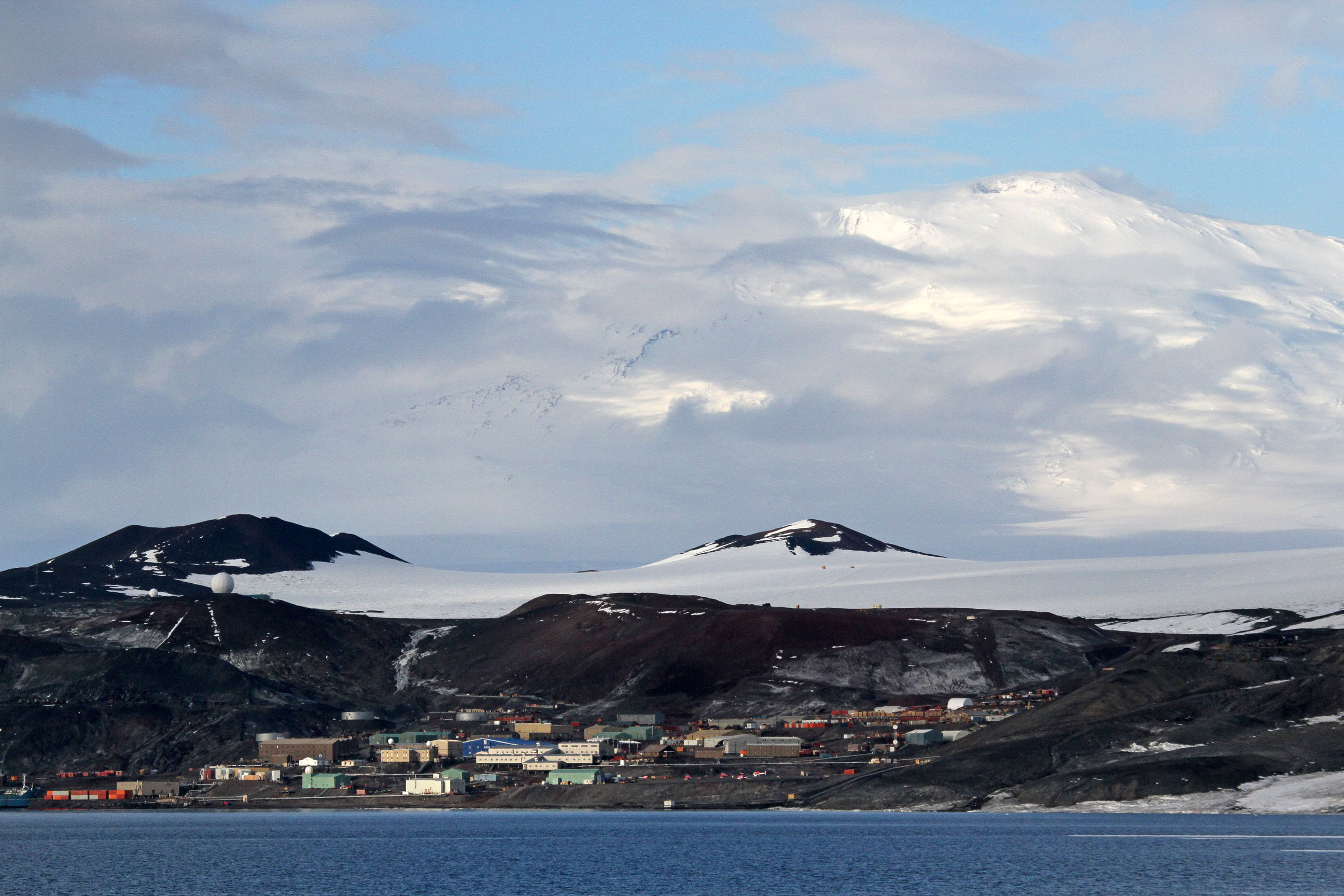 McMurdo Station, the US Antarctic research base with an imposing Mt. Erebus volcano in the distance.