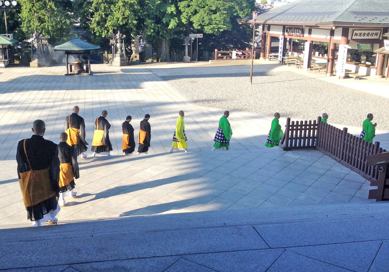 Monks leaving the temple after their early morning chant and prayer.