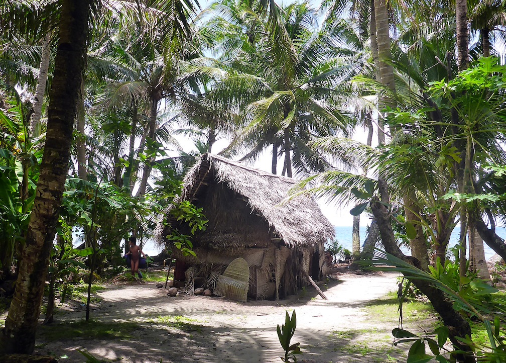 A typical home on Ifalik Island.  Most homes we encountered through FSM were traditional thatched huts.
