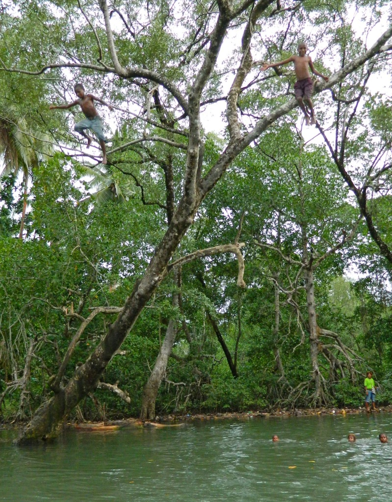 Kids were leaping out of the trees and playing around us on the river banks around Madang.