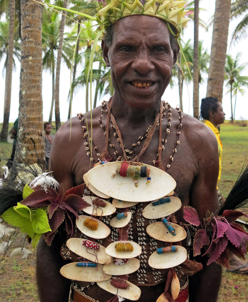 Welcoming us to PNG were many performers like this man flashing his betel nut smile.