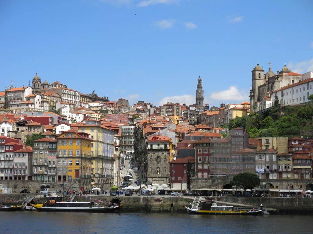 Porto in the sunshine reveals red-tiled roofs and colorful buildings.